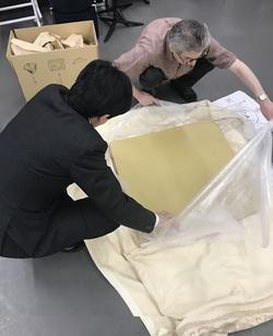 tak tomoaki unwrapping.JPG